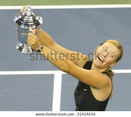 FLUSHING, NY - SEPT 9: Maria Sharapova (RUS) holds her trophy after beating Justine Henin-Hardenne (BEL) to win the ladies singles final at the U.S. Open on September 9, 2006 in Flushing, New York. - stock photo
