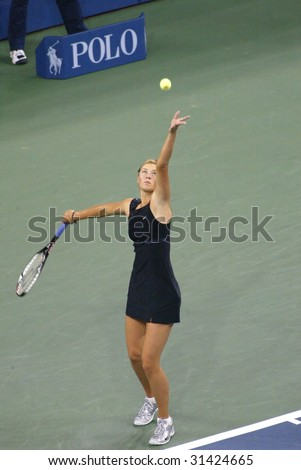 FLUSHING, NY - SEPT 9: Maria Sharapova (RUS) prepares to serve to Justine Henin-Hardenne (BEL) prior to winning the ladies singles final at the U.S. Open on September 9, 2006 in Flushing, New York. - stock photo