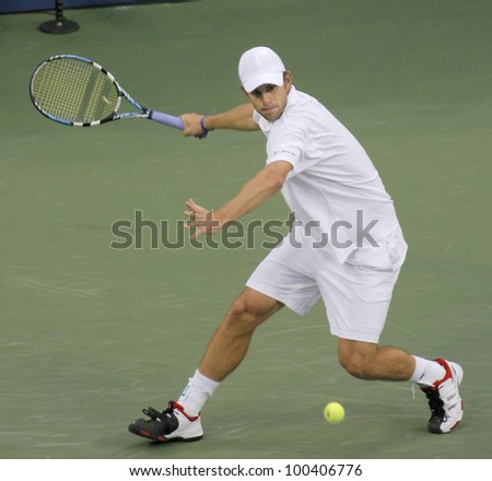 FLUSHING, NY - SEPTEMBER 10: Andy Roddick serves to Roger Federer during the US Open at the USTA National Tennis Center on September 10, 2006 in Flushing, NY. - stock photo