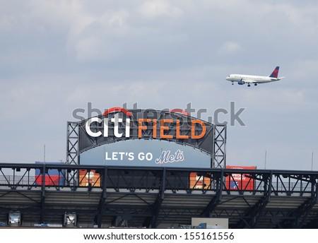 FLUSHING, NY - SEPTEMBER 8: Delta Airlines jet flying over Citi Field, home of major league baseball team the New York Mets on September 8, 2013 in Flushing, NY - stock photo