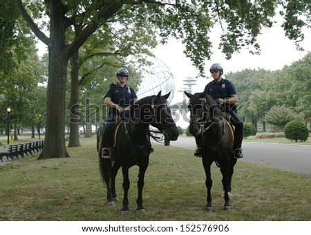 FLUSHING, NY- SEPTEMBER 2 : NYPD police officers on horseback ready to protect public at Billie Jean King National Tennis Center during US Open 2013 on September 2, 2013 in Flushing, NY  - stock photo