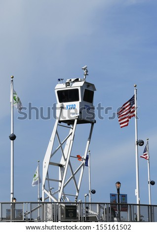 FLUSHING, NY- SEPTEMBER 9: NYPD Sky Watch platform placed near National Tennis Center on September 9, 2013 in Flushing. SkyWatch platform provides flexible surveillance options for high level security