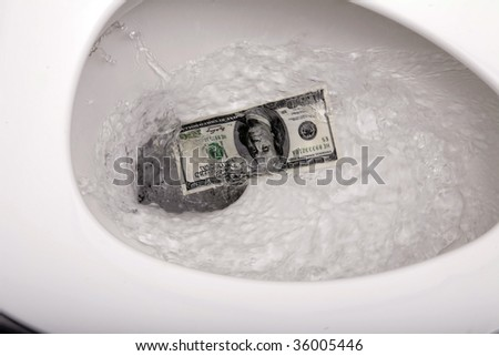 Flushing one hundred dollars down the toilet - stock photo