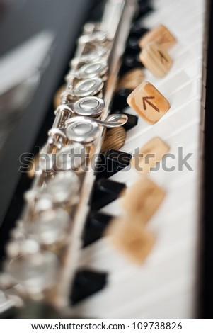 flute and the runes on the keyboard