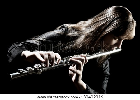 Flute music flutist instrument playing. Classical orchestra musician. Focus is on the hands with instrument - stock photo