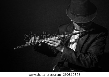 Flute music playing flutist musician performer on black background, musical instrument