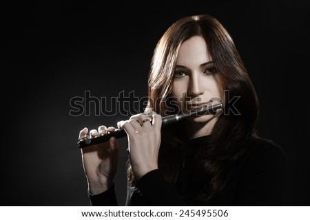 Flute piccolo Woman playing flute music instrument - stock photo