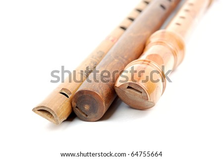 Flutes - Handcrafted wood recorder on white background