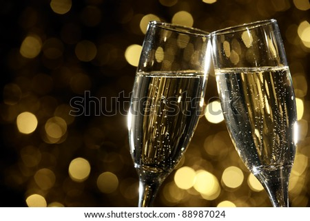 Flutes of champagne in holiday setting,Closeup... - stock photo