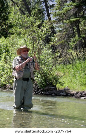Fly Fisher in Stream