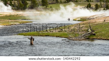 Fly fisherman at Firehole River, Yellowstone National Park - stock photo