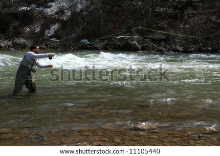 Fly Fisherman Casting - stock photo
