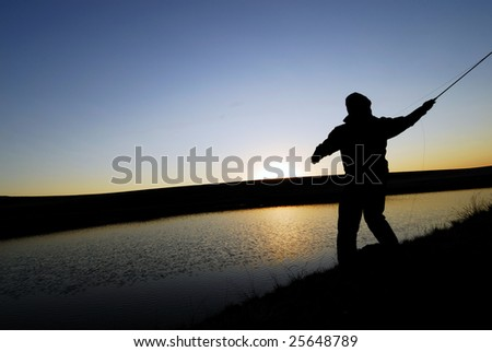 Fly Fisherman Silhouette - stock photo