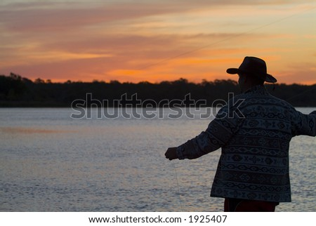 Fly fishing in the morning sun 12 - stock photo