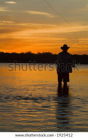 Fly fishing in the morning sun 17 - stock photo