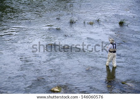 fly fishing on the creek - stock photo