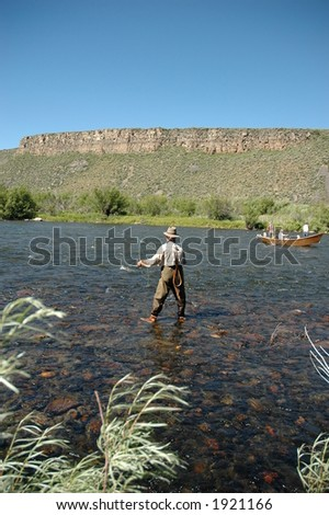 Fly fishing on the Madison River - stock photo