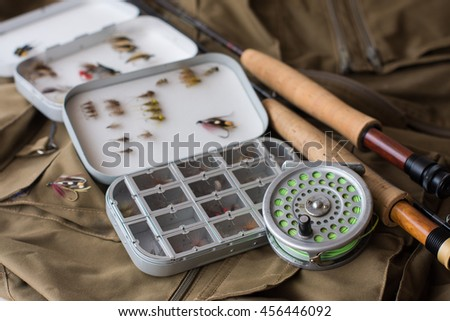 fly fishing tackle, old reel, vintage - stock photo