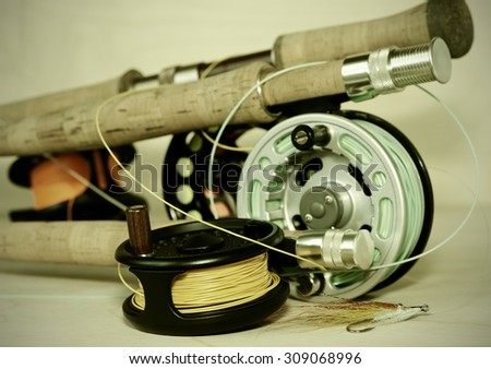 Fly rods and rees.Fishing accessories.Tinted image.