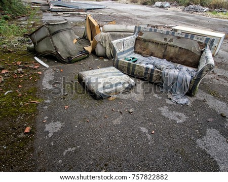Fly tipping of rubbish on roadside. Environmental pollution. Urban waste. With copy space.