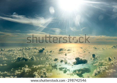 flying above the beautiful clouds in the sky - stock photo