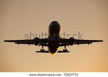 Flying aircraft at sunset