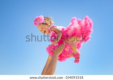 Flying baby on sky background