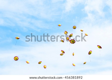 Flying balloons in the sky at the prom - stock photo
