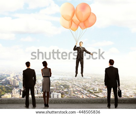 flying balloons with Businessman on a city background - stock photo