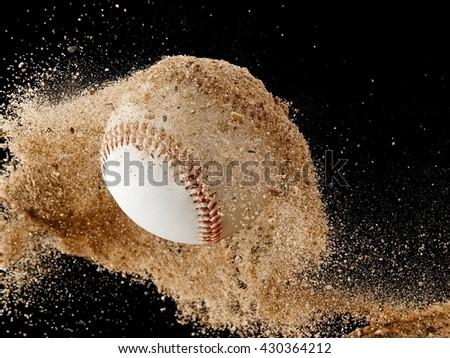 Flying baseball ball with sand - stock photo