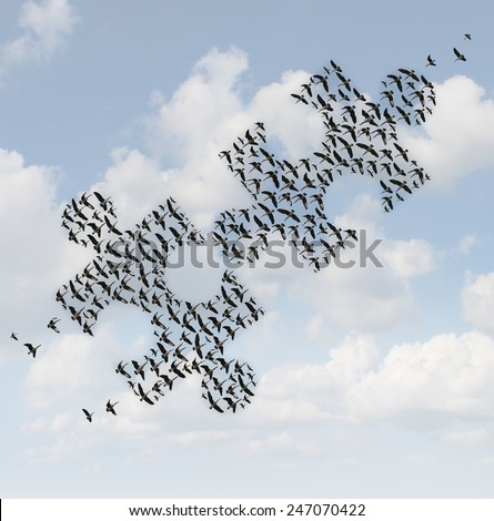 Flying birds puzzle as a business concept for group strategy as two flocks of geese shaped as jigsaw puzzle pieces joining together as a teamwork success metaphor. - stock photo