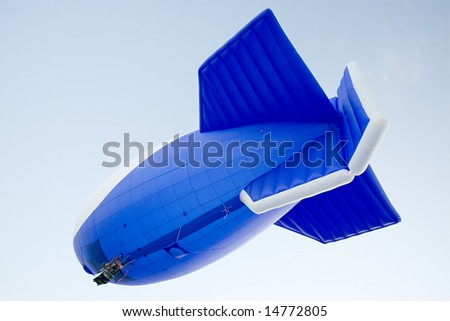 flying blimp on clear blue sky background - stock photo