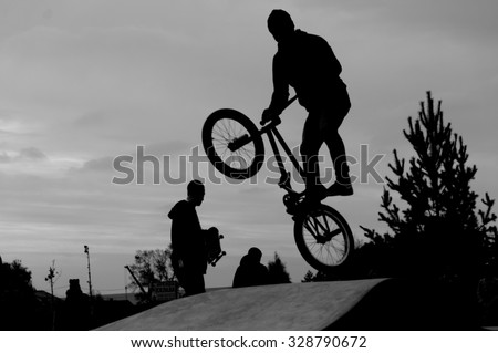 Flying bmx rider in the park - stock photo