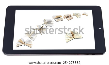 flying books on display of tablet pc isolated on white background - stock photo