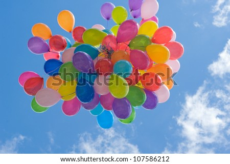 flying bunch of colorful balloons - stock photo