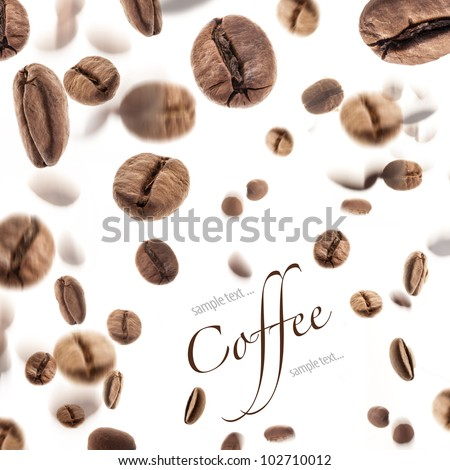 Flying coffee beans, isolated on white background (with sample text) - stock photo
