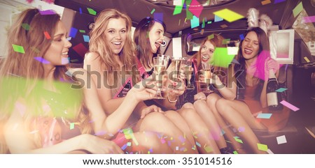 Flying colours against happy friends drinking champagne in limousine