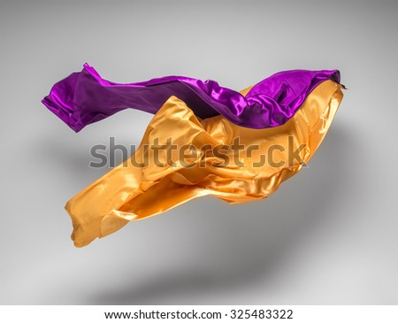flying fabric - high speed studio shot, art object, design element - stock photo