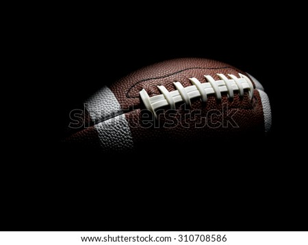 Flying Football on Black - stock photo
