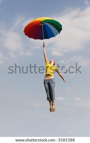 Flying girl with umbrella - stock photo