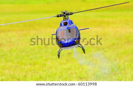 Flying helicopter (radio controled scale-model 1:24 scale) Teleobjective shot with shallow DOF. - stock photo