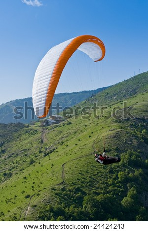 Flying in the mountains - stock photo