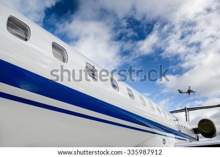 Flying Let l-410 and Embraer ERJ 145 - stock photo