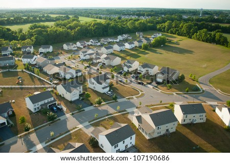 Flying low over a suburb - stock photo