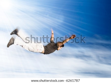 Flying man. Young man falling down on sky background. - stock photo