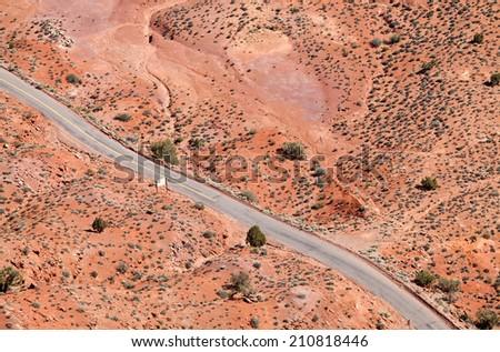 Flying over desert road - stock photo