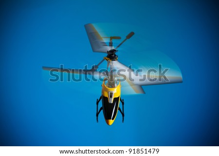 Flying RC helicopter - stock photo