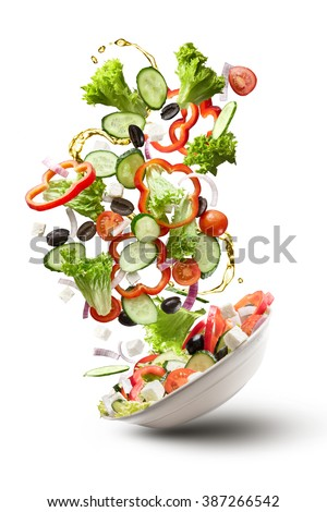 flying salad isolated on white background. Greek salad: red tomatoes, pepper, cheese, lettuce, cucumber, olives and olive oil - stock photo