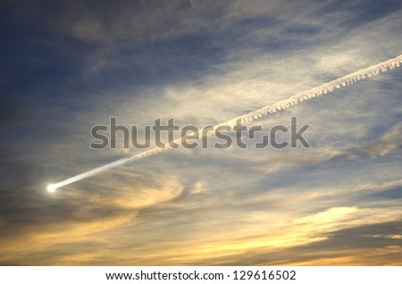 flying smoky meteor on background of sky - stock photo