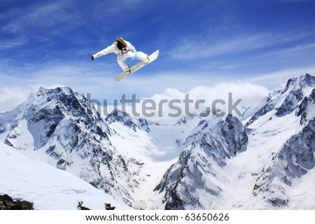 flying snowboarder on mountains - stock photo
